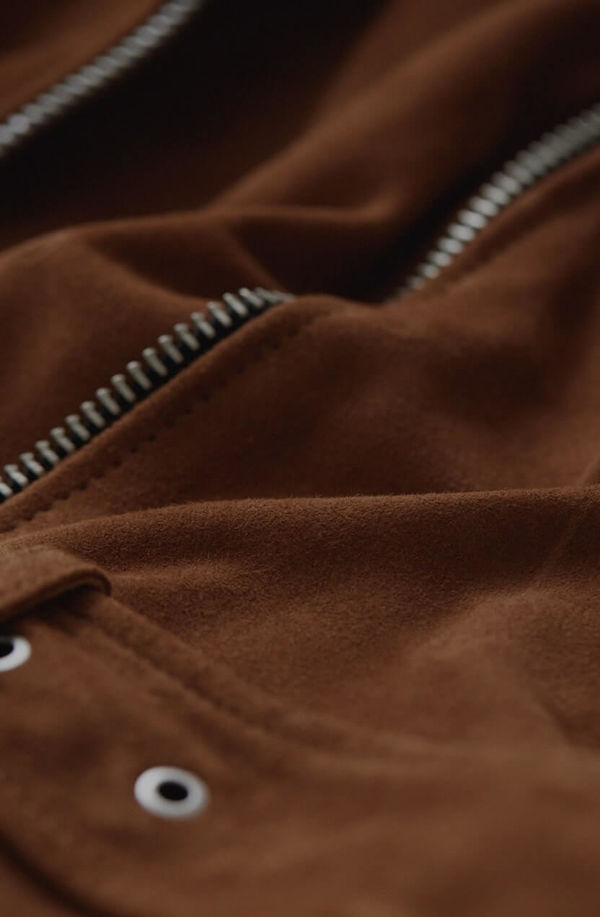 Zoom the zip of a leather jacket.